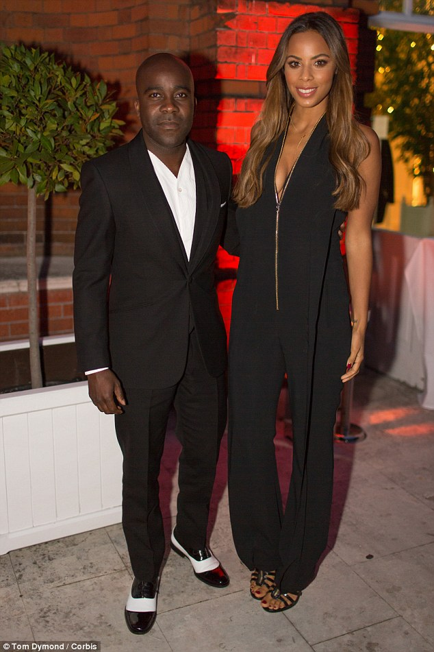 Taking the plunge: Rochelle Humes looked set for a night on the tiles in her soft black jumpsuit, complete with a chest-baring zip detail down the front, as she posed for a snap with The Xtra Factor co-host Melvin Odoom