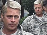 **USA ONLY** Paris, France - Brad Pitt is spotted on set of his new movie 'War Machine' at the Grand Hotel in Paris. The 52-year-old actor is in character wearing camo gear to film a scene.