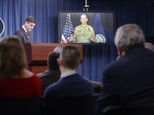 Lieutenant General Sean MacFarland speaks via teleconference from Baghdad, Iraq as Pentagon Press Secretary Peter Cook listens during a media briefing on Operation Inherent Resolve on February 1, 2016 in Arlington, Virginia ©Olivier Douliery (Getty/AFP)