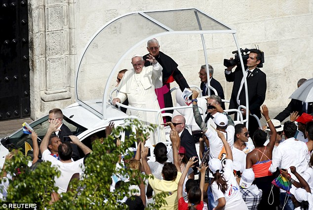 Whirlwind tour:Pope Francis waves to the crowd in Santiago de Cuba Tuesday. The pontiff was wrapping up his Cuba visit before heading to the United States