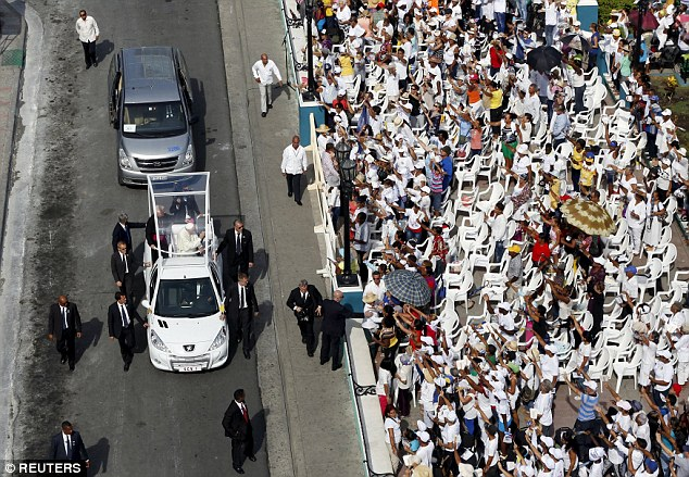 The pontiff, pictured waving to the crowd in Santiago de Cuba from his Pope-mobile, will visit Washington DC, New York and Philadelphia this week