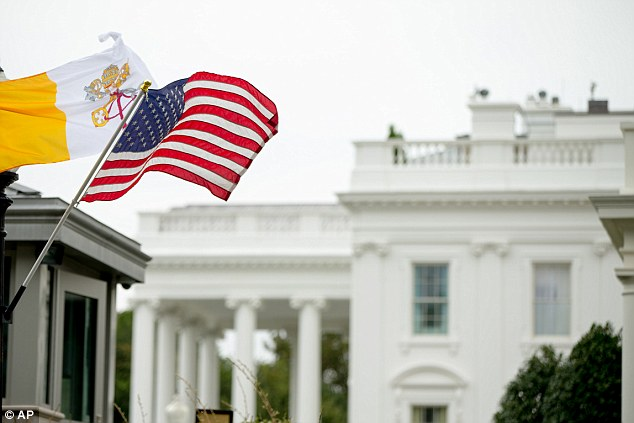 Winters and her wife will be among some 15,000 people at the closed-to-the-public welcoming ceremony for the pontiff Wednesday on the South Lawn. In this picture, the Flag of Vatican City flies next to American flags along West Executive Avenue outside of the White House Monday