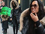 EXCLUSIVE: Padma Lakshmi with a friend and her daughter Krishna Thea Lakshmi-Dell with a banner seen in New York February 1, 2016\n\nPictured: Padma Lakshmi, Krishna Thea Lakshmi-Dell\nRef: SPL1217077  010216   EXCLUSIVE\nPicture by: NIGNY / Splash News\n\nSplash News and Pictures\nLos Angeles: 310-821-2666\nNew York: 212-619-2666\nLondon: 870-934-2666\nphotodesk@splashnews.com\n