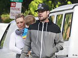 51592848 Singer and actress Hilary Duffy and her estranged husband Mike Comrie find a parking ticket on their car after taking their son Luca out to breakfast in West Hollywood, California on November 23, 2014. Hilary is enjoying some quality family time after returning from NYC where she was filming scenes for the new TV series 'Younger.' FameFlynet, Inc - Beverly Hills, CA, USA - +1 (310) 505-9876