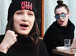 EXCLUSIVE TO INF.\nJanuary 31, 2016: Bella Hadid seen having lunch with friends. During the meal she can be seen making funny faces at her male companion, New York City.\nMandatory Credit: INFphoto.com Ref.: infusny-198/204