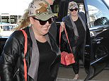 Rebel Wilson is all smiles as she's  spotted in leather pants and a leather jacket with an army truckers cap.  The adorable Australian actress/comedian was seen flying out of LAX\n\nPictured: Rebel Wilson\nRef: SPL1219084  010216  \nPicture by: Sharky / Splash News\n\nSplash News and Pictures\nLos Angeles: 310-821-2666\nNew York: 212-619-2666\nLondon: 870-934-2666\nphotodesk@splashnews.com\n