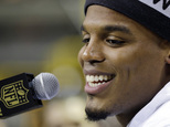 Carolina Panthers' Cam Newton answers a question during Opening Night for the NFL Super Bowl 50 football game Monday, Feb. 1, 2016, in San Jose, Calif. (AP Photo/David J. Phillip)