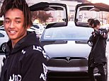 *EXCLUSIVE* **SHOT ON 2/1/16** Calabasas, CA - Jaden Smith must have super powers because he just scored one of the very first Tesla Model X gull wing SUV's. Jaden posed with his new toy and showed off the bat doors as the sun set in Los Angeles. Jaden also happens to be rocking purple nail polish!!!\nAKM-GSI          February 2, 2016\nTo License These Photos, Please Contact :\nSteve Ginsburg\n(310) 505-8447\n(323) 423-9397\nsteve@akmgsi.com\nsales@akmgsi.com\nor\nMaria Buda\n(917) 242-1505\nmbuda@akmgsi.com\nginsburgspalyinc@gmail.com