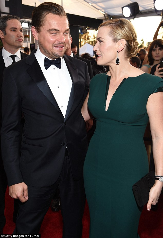 Old friends: Kate wore a green Armani gown for the Screen Actors Guild awards on Saturday night where she met up with her pal and Titanic co-star Leonardo DiCaprio