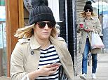 02.FEB.2016 - LONDON - UK **EXCLUSIVE ALL ROUND PICTURES** Presenter Caroline Flack does a spot of shopping at Accessorize at Euston station after getting back from a skiing trip in Switzerland! BYLINE MUST READ : XPOSUREPHOTOS.COM ***UK CLIENTS - PICTURES CONTAINING CHILDREN PLEASE PIXELATE FACE PRIOR TO PUBLICATION *** **UK CLIENTS MUST CALL PRIOR TO TV OR ONLINE USAGE PLEASE TELEPHONE  44 208 344 2007 ***