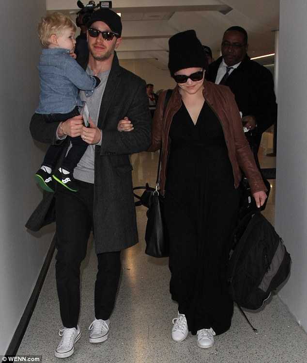 Cosy co-stars: Goodwin wore the loose-fitting black number as she headed back to Vancouver where she and Dallas film their hit ABC show, Once Upon a Time
