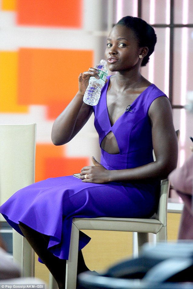 Cooling off: Once at the Today Show, Lupita took off her coat and sipped on a bottle of water while waiting to take the stage