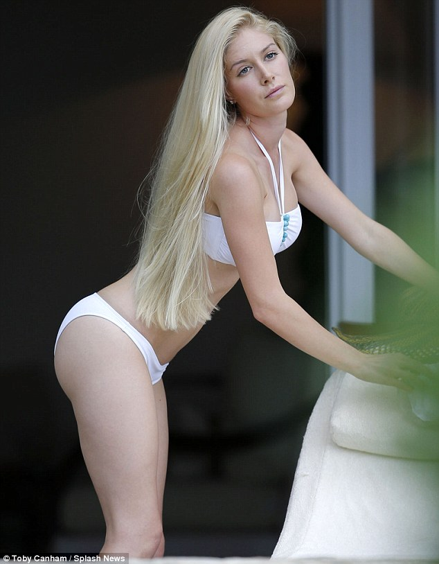 Too much too young: She also had liposuction on her waist, hips and inner and outer thighs; a buttock augmentation, and breast implants at just 23