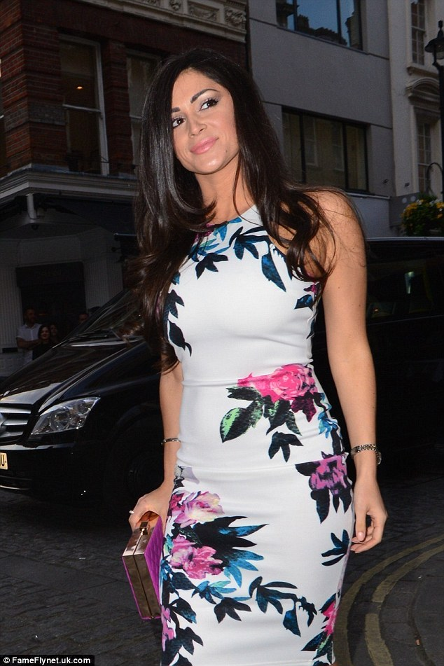 Spring chicken: She accessorised the pink and white dress with a colour pop clutch bag