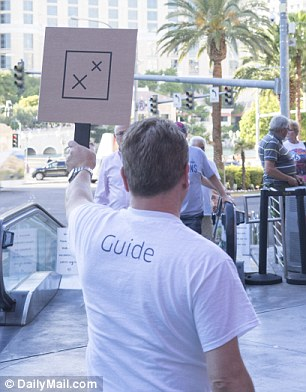 A guide hangs out along the Vegas strip to help guests arriving for Uber's lavish affair