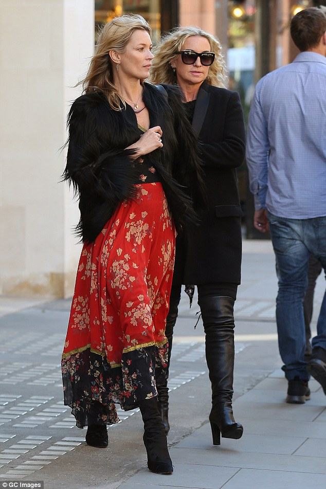 Leggy:The British supermodel - who has a daughter Lila Grace, 12, with ex-boyfriend Jefferson Hack - added some height with a pair of black, pointed ankle boots