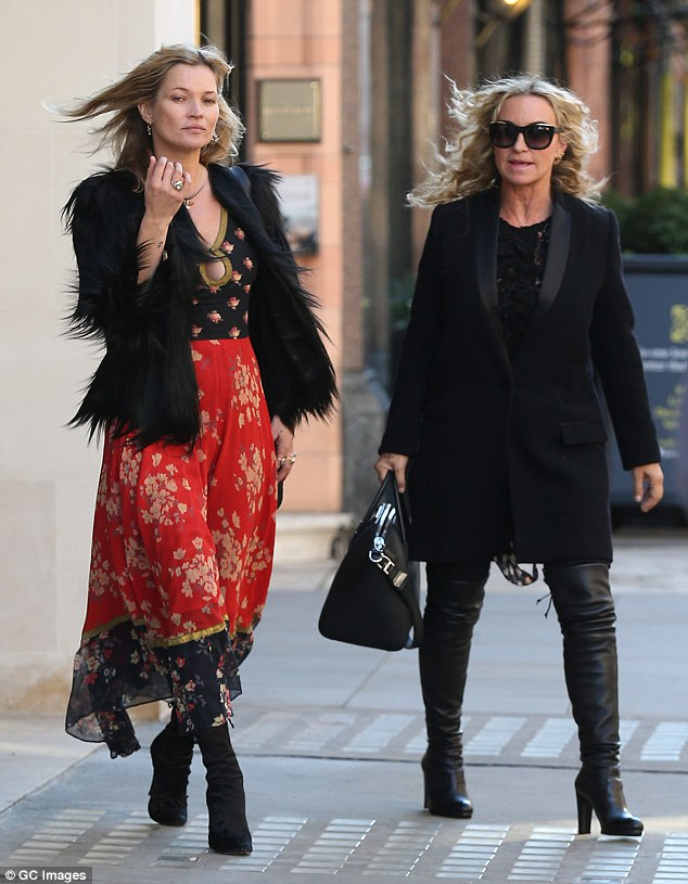 Fashionable friend:The blonde beauty was joined by pal Meg Matthews for her glamorous day out, who looked professional in a black tuxedo jacket, worn with black leather over-the-knee boots and sunglasses