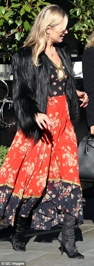 Flattering: The dress featured a pretty floral pattern and a flowing, ankle-length hem
