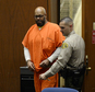 "FILE - In this April 30, 2015 file photo, Marion ""Suge"" Knight is escorted into court for his arraignment on murder charges in Los Angeles. Court records show a Los Angeles judge on Friday, Jan. 29, 2016, cut off Knight's access to phone calls, visitors and mail from anyone except his attorneys at the request of sheriff's investigators.  (Kevork Djansezian/Pool Photo via AP, File )"