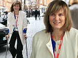 3 Feb 2016 - London - UK  Make Up free Fiona Bruce arriving at BBC TV studios with her foot in a plaster cast.  Fiona looked tired and pale as she chatted with her friend - London   BYLINE MUST READ : XPOSUREPHOTOS.COM  ***UK CLIENTS - PICTURES CONTAINING CHILDREN PLEASE PIXELATE FACE PRIOR TO PUBLICATION ***  **UK CLIENTS MUST CALL PRIOR TO TV OR ONLINE USAGE PLEASE TELEPHONE   44 208 344 2007 **