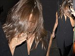 Selena Gomez looks worse for wear with her hair covering her face as she leaves through the back door of 'The Nice Guy' bar in West Hollywood, CA\n\nPictured: Selena Gomez\nRef: SPL1220115  030216  \nPicture by: SPW / Splash News\n\nSplash News and Pictures\nLos Angeles: 310-821-2666\nNew York: 212-619-2666\nLondon: 870-934-2666\nphotodesk@splashnews.com\n