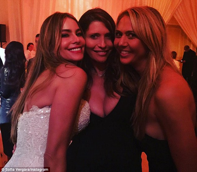 Memories: In another shot, she grins widely with two others, giving a closer look at the intricate beading on her dress; Sofia with Valentina Micchetti and a friend