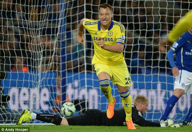 Terry turns and celebrates after making it 2-1 to Chelsea with a close-range finish against Leicester City