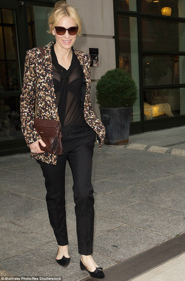Bold: The A-lister showed no trace of embarrassment as she left hotel having recycled her see-through top and cigarette pants
