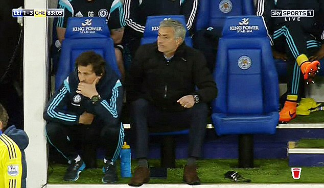 Jose Mourinho watches on with muddy shoes just as his side scored against Leicester City