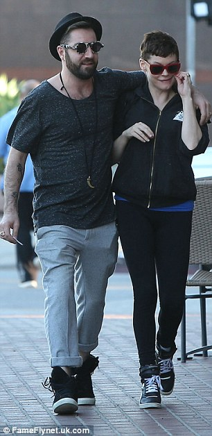 Casual couple:Her partner Davey also wore a laid-back outfit dressed in a black T-shirt, grey trousers and monochrome sunglasses