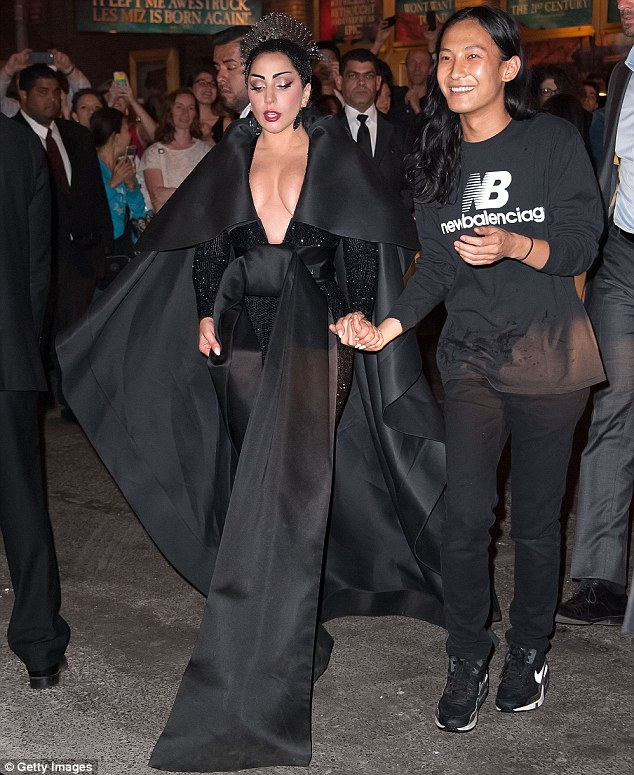 Hostess with the mostess: Alexander Wang held hands with Lady Gaga as they arrived at her afterparty at the Diamond Horseshoe late on Monday night