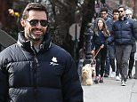 New York, NY - Hugh Jackman has a busy Saturday morning as he goes on a bike ride before walking the dogs with his kids and friends. The large group then made their way to lunch on the brisk NYC day. \n  \nAKM-GSI       February 6, 2016\nTo License These Photos, Please Contact :\nSteve Ginsburg\n(310) 505-8447\n(323) 423-9397\nsteve@akmgsi.com\nsales@akmgsi.com\nor\nMaria Buda\n(917) 242-1505\nmbuda@akmgsi.com\nginsburgspalyinc@gmail.com