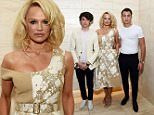 """LOS ANGELES, CA - FEBRUARY 05:  (L-R) Dylan Lee, actress Pamela Anderson and Brandon Lee attend the Los Angeles special screening and reception of """"Connected"""" at Milk Studios on February 5, 2016 in Los Angeles, California.  (Photo by Amanda Edwards/WireImage)"""