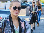 West Hollywood, CA -  Rita Ora grabbed some lunch with her gal pals and was sporting a unique outfit consisting of a Japanese kimono, cropped leggings, blue v-neck, and a pair of sneakers. The singer decided to mess with photographers and stuck her tongue out at them playfully before getting into her car. She seemed in a good mood despite the recent lawsuit from her label, Roc Nation, for not following her contract.    AKM-GSI       February 5, 2016 To License These Photos, Please Contact : Steve Ginsburg (310) 505-8447 (323) 423-9397 steve@akmgsi.com sales@akmgsi.com or Maria Buda (917) 242-1505 mbuda@akmgsi.com ginsburgspalyinc@gmail.com