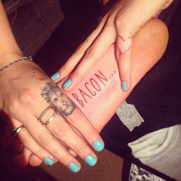 Favourite artist: Bang Bang is reponsible for many of Cara's tattoos, including the 'Bacon' stamp on the bottom of her foot and the Lion on her finger