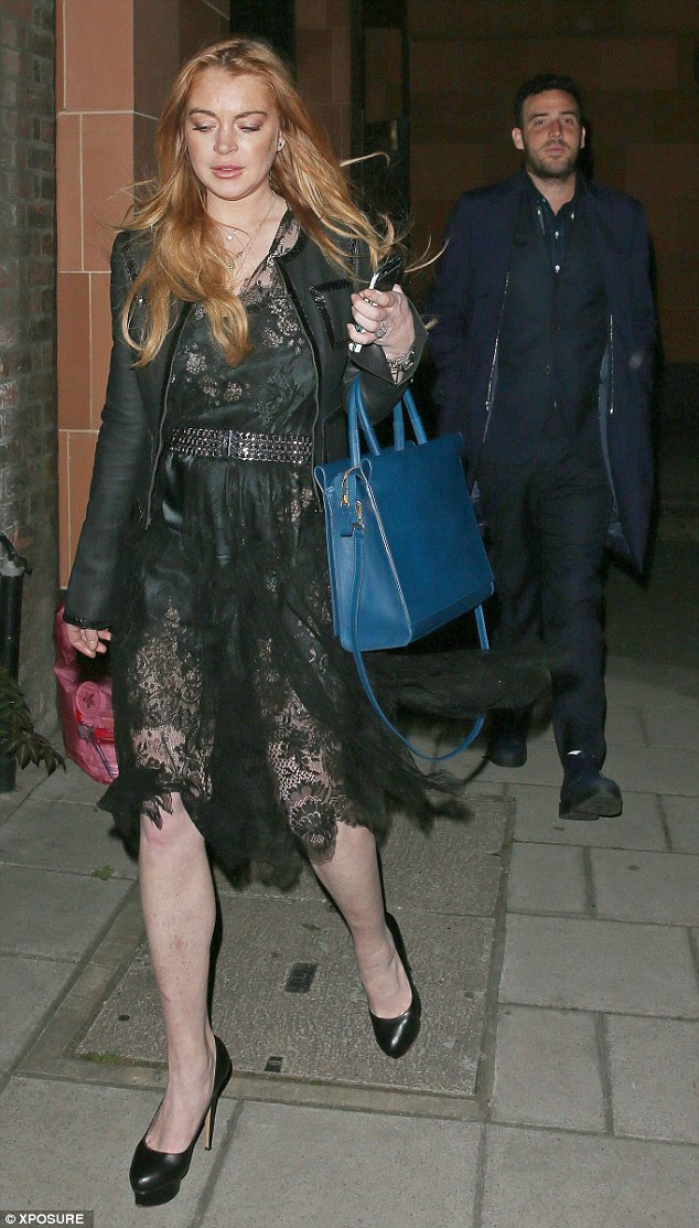 Racy: The star's sheer dress flashed some leg with Lindsay accessorized with a pair of platform heels and a fitted black blazer