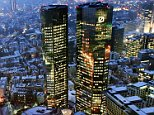 The twin towers of the Deutsche Bank building are seen in Frankfurt, central Germany, in this Jan. 26, 2006 file picture. The bank, Germany's biggest, said Thursday, March 9, 2006 it was reducing its 2005 net profit by 250 million Euro (US$ 298 million) to cover newly discovered legal risks dating back nearly a decade. Taking account of the adjustments, Deutsche said it had fourth-quarter net profit of 500 million Euro (US$ 600 million). Full-year net profit was 3.5 billion Euro (US$ 4.2 billion), the bank said. (AP Photo/Michael Probst)