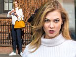 EXCLUSIVE: Karlie Kloss looks casual chic and carries fierce Louis Vuitton orange bag during a photo shoot in West Village in New York City.\n\nPictured: Karlie Kloss\nRef: SPL1221298  060216   EXCLUSIVE\nPicture by: Allan Bregg/Splash News\n\nSplash News and Pictures\nLos Angeles: 310-821-2666\nNew York: 212-619-2666\nLondon: 870-934-2666\nphotodesk@splashnews.com\n