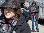 """*EXCLUSIVE* Dawson, GA - Winona Ryder tries to stay hidden under her visor on the set of """"Stranger Things"""" which is a television drama series that is slated to debut in 2016 on Netflix. Although the actress tugs her visor down to hide her face, she still smiles as she notices the cameras. \n  \nAKM-GSI      February 5, 2016\nTo License These Photos, Please Contact :\nSteve Ginsburg\n(310) 505-8447\n(323) 423-9397\nsteve@akmgsi.com\nsales@akmgsi.com\nor\nMaria Buda\n(917) 242-1505\nmbuda@akmgsi.com\nginsburgspalyinc@gmail.com"""