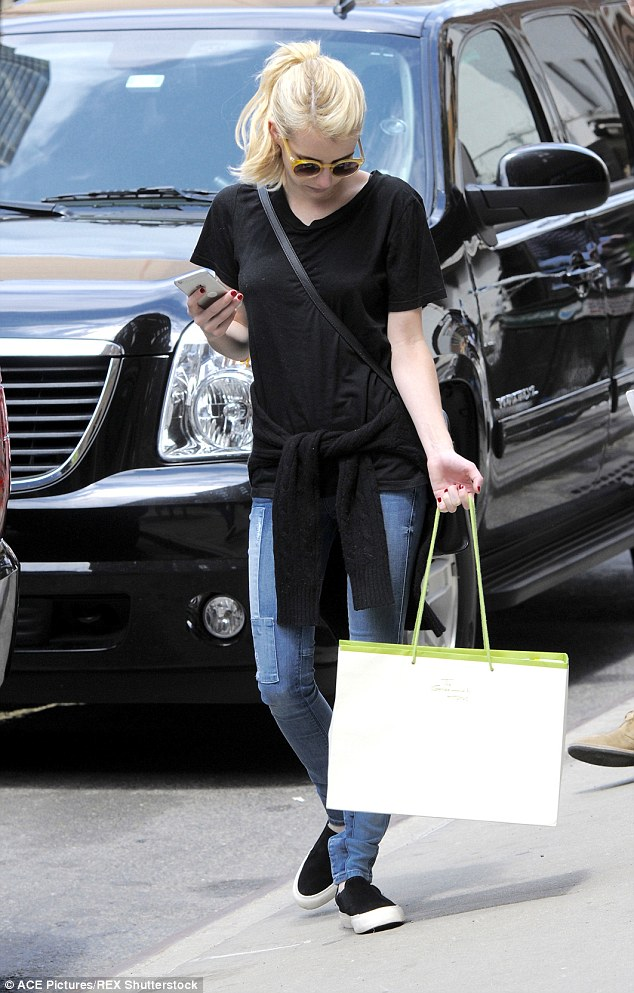 It's in the bag: The star checked her phone after shopping in Soho, New York
