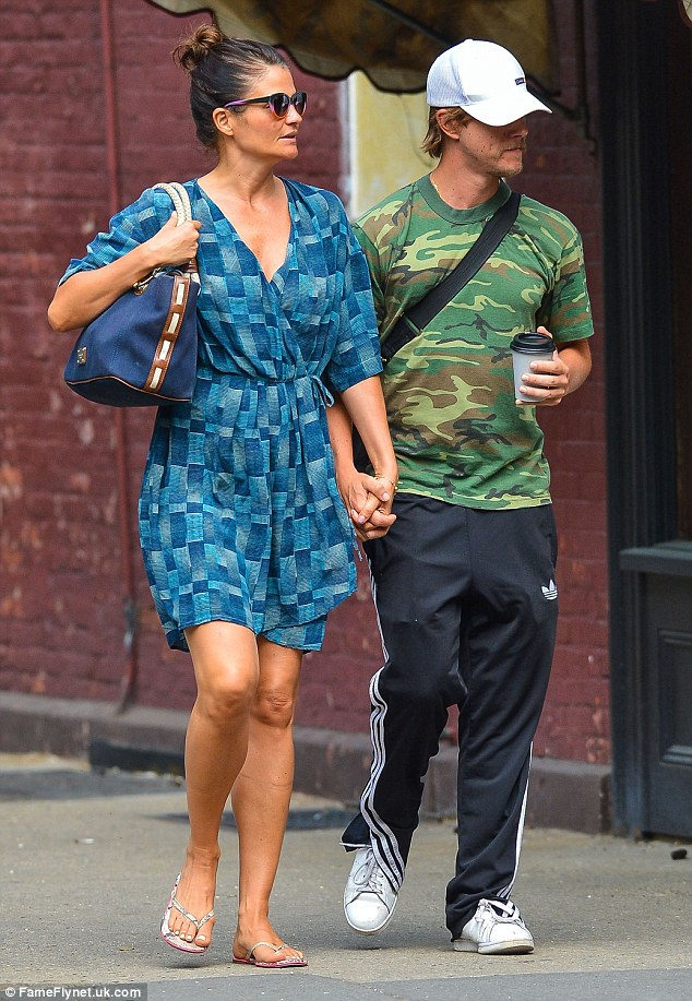 Off duty style: The 46-year-old Danish beauty looked pretty in a blue wrap dress and flip flops
