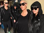 EXCLUSIVE: ***PREMIUM EXCLUSIVE RATES APPLY*** Blac Chyna appears to ignore questions about Rob Kardashian and her airport troubles as she lands in Trinidad Tobago just days after being arrested at Austin Airport. The model arrived alongside Amber Rose, who has been dealing with her own controversy after a Twitter feud with Kanye West, as they are both set to take part in the world famous Trinidad carnival. Blac Chyna was arrested for alleged public intoxication after getting on a flight to London at Austin airport on January 29th.\nPhotos taken on February 7th 2016\n\nPictured: Amber Rose and Blac Chyna \nRef: SPL1218647  080216   EXCLUSIVE\nPicture by: Charlie Pitt/246paps/Splash News\n\nSplash News and Pictures\nLos Angeles: 310-821-2666\nNew York: 212-619-2666\nLondon: 870-934-2666\nphotodesk@splashnews.com\n