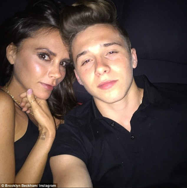 Mum and me: 16-year-old Brooklyn and Victoria cosied up for a party selfie as the celebrations continued into the night