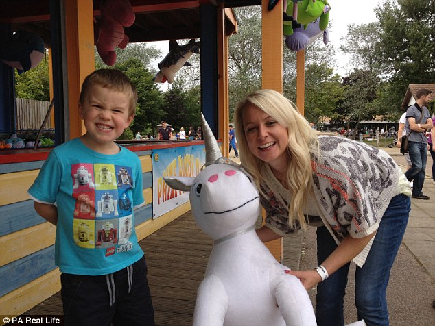 Hannah Parker plays with her nephew two months before her 2012 diagnosis