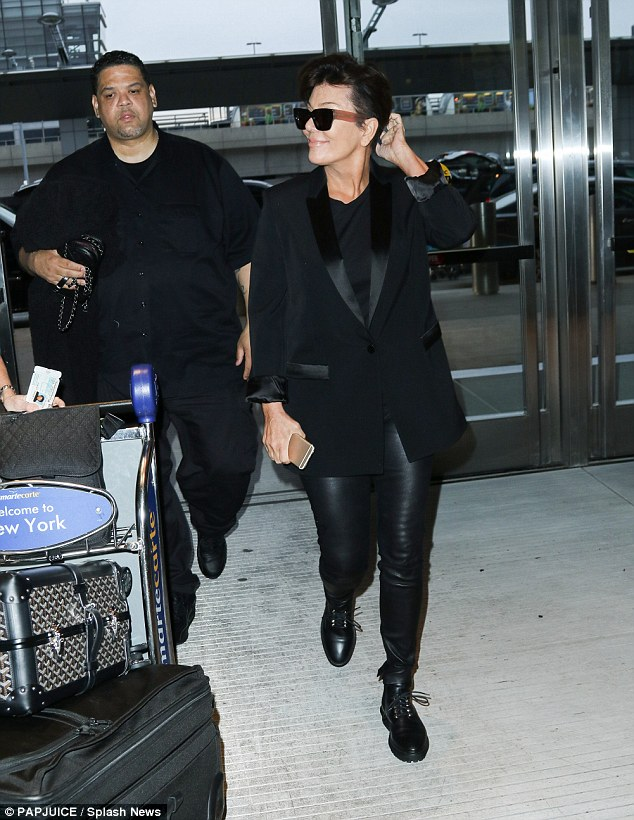 Cool customer: For her day of travel Kris completed her attire with lace up combat boots and a shiny black blazer as she rocked large sunglasses