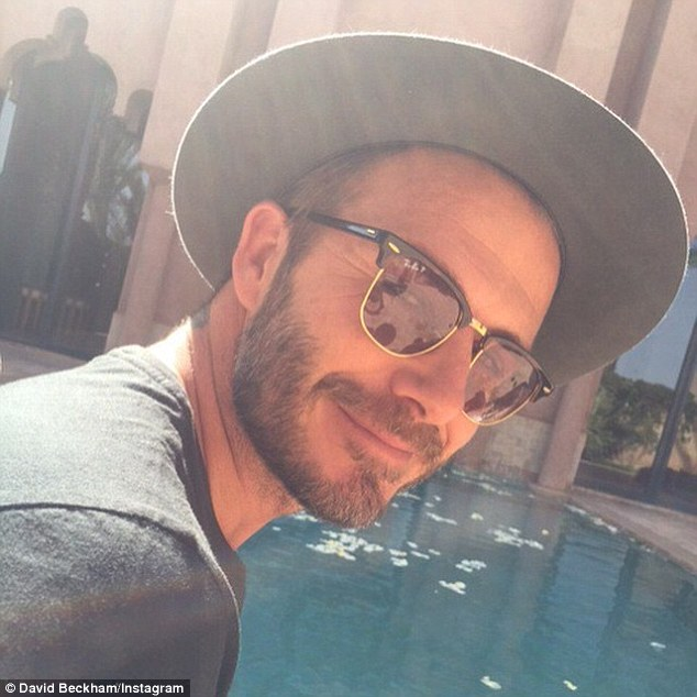 Centre of attention:In another he idled close to the sprawling pool outside five-star Marrakech resort Amanjena, where he will celebrate his birthday over the course of the weekend