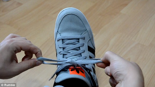 Step 5: This move sees each hand releasing its own loop and pulling the loose end of the opposite loop through its own