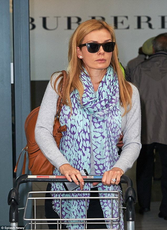 Back on home turf: Katherine touched down at Heathrow airport in London on Wednesday morning