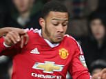 MANCHESTER, ENGLAND - FEBRUARY 08:  Memphis Depay of Manchester United U21s in action with Reece Hall-Johnson of Norwich City U21s during the U21 Premier League match between Manchester United U21s and Norwich City U21s at Old Trafford on February 8, 2016 in Manchester, England.  (Photo by John Peters/Man Utd via Getty Images)