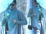 Picture Shows: Anne Hathaway  February 05, 2016    Shy actress Anne Hathaway was spotted visiting the gym in West Hollywood, California. Anne used an umbrella to hide her face from the cameras.    Exclusive - All Round  UK RIGHTS ONLY    Pictures by : FameFlynet UK © 2016  Tel : +44 (0)20 3551 5049  Email : info@fameflynet.uk.com